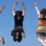 three young girls jumping in the air