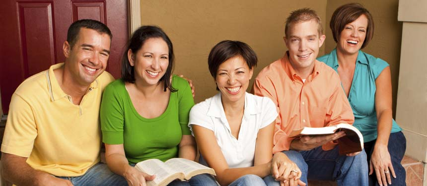 a family reviewing books while smiling